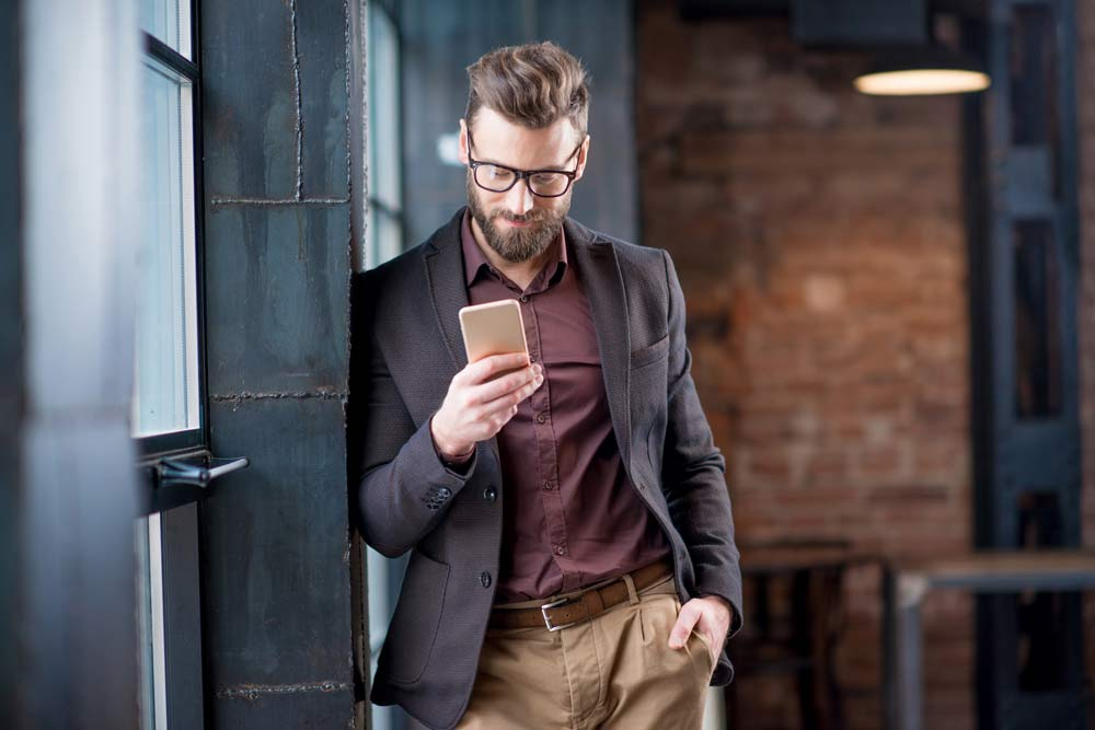 man networking on phone