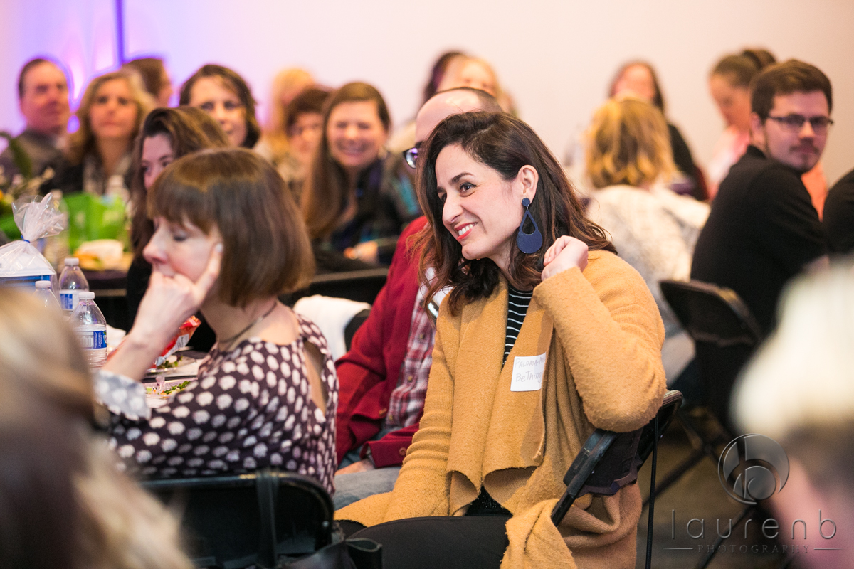 woman smiling during networking event