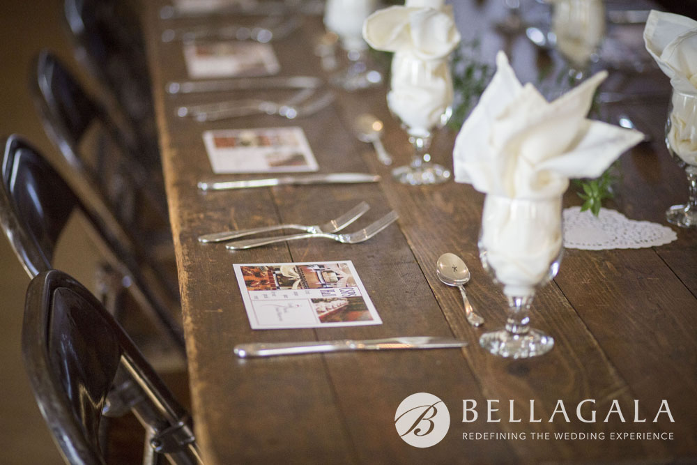 wood table setting with silverware and glasses with napkin flute