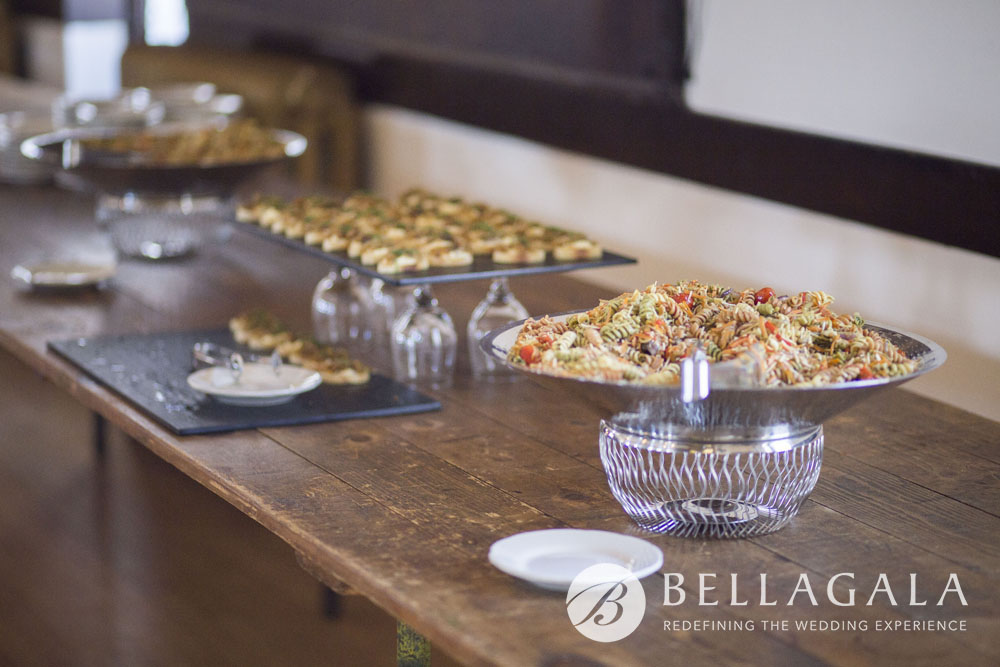 pasta salad and appetizers on wood table