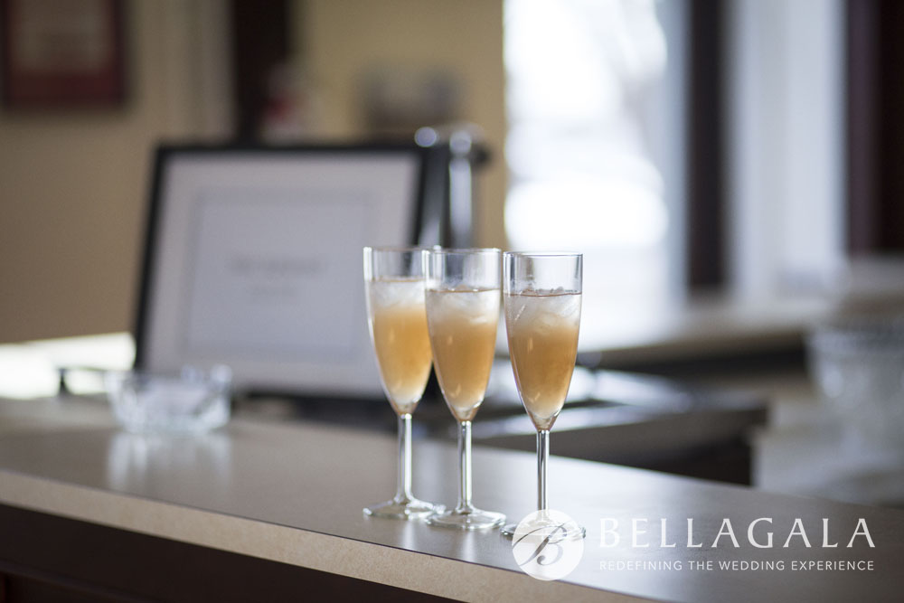 3 champagne flutes on wood counter